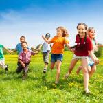 Happy kids running in nature